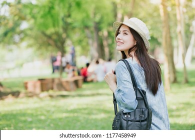teen with shoulder bag summer walking in the green park