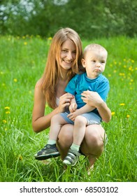 Teen sister and baby brother in grass meadow