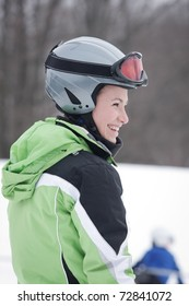 Teen Skier against background of snow and woods.