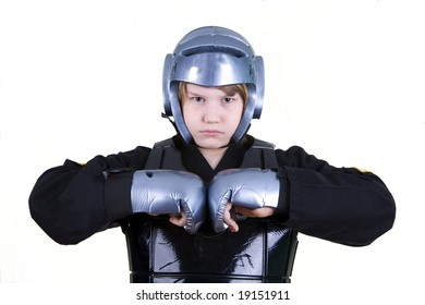 A teen in sparring gear and a karate uniform.