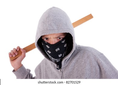 A teen with a stick, in a act of juvenile delinquency, in white background, studio session