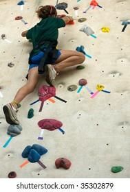 Teen taking a BIG step up an artificial wall