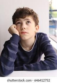 teen thinking european white boy close up photo in cafe
