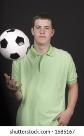 Teen tossing a soccer ball in the air
