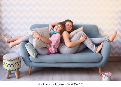 teen two girls on pajama party with pillows