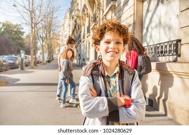 Teen walking around the streets with friends