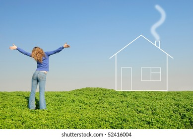 Teen in a wheaten field looks at house