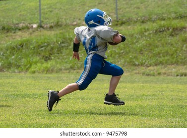 Teen Youth Football Player Running for the Touchdown