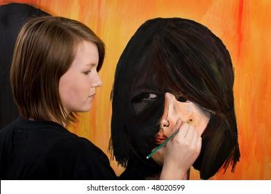 Teenage artist painting self-portrait