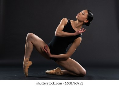 Teenage Asian girl in ballet dance pose for portrait