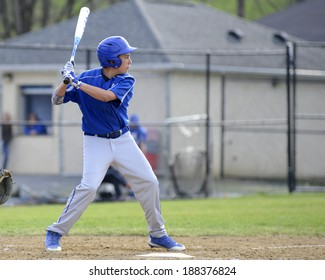 teenage baseball player in the batter's box