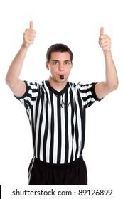 Teenage basketball referee giving sign for jump ball