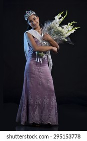 Teenage beauty queen with a bouquet