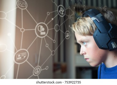Teenage blond boy playing computer games on PC. Global network
