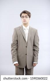 Teenage boy in baggy business suit
