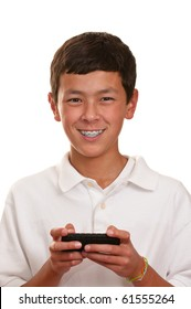 Teenage boy with brown hair and eyes in a white shirt using his cellphone to talk and text.