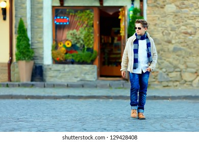 teenage boy crossing the street of old town