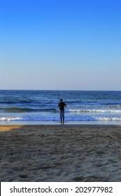 Teenage Boy Fishing in the Indian Ocean