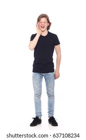 Teenage boy full body in front of a white background