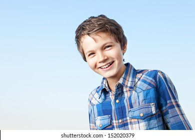 A teenage boy is giving a big smile