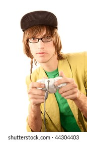 Teenage boy in glasses holding electronic game controller