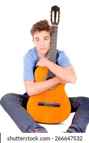 teenage boy with guitar isolated in white