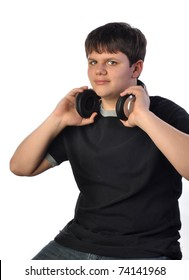 Teenage boy with headset listing to music on white set