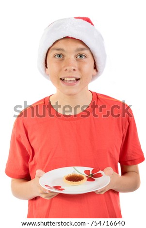 Teenage boy with a jam tart