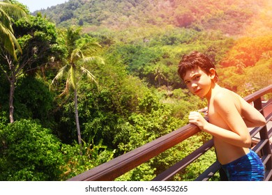 teenage boy on the balkony on the asian jungle forest background close up photo
