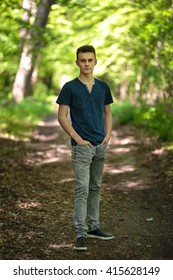 Teenage boy in the park in various postures