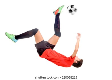 teenage boy playing soccer isolated in white