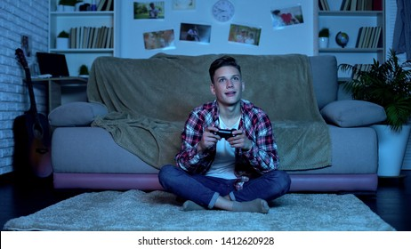 Teenage boy playing video game late at night addiction, lack of parental control