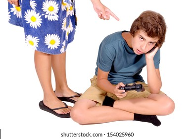 teenage boy playing video games while mother argues