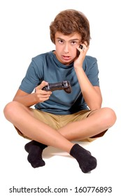 teenage boy playing video games isolated in white