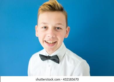 Teenage boy portrait on colorful background wall