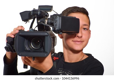 Teenage boy practicing filming with a professional video camera. Education and technology. With excellent clipping path.