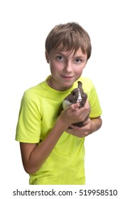 Teenage boy with a rabbit in her arms. Isolated on white background