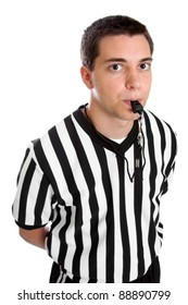Teenage boy referee blowing his whistle isolated on a white background