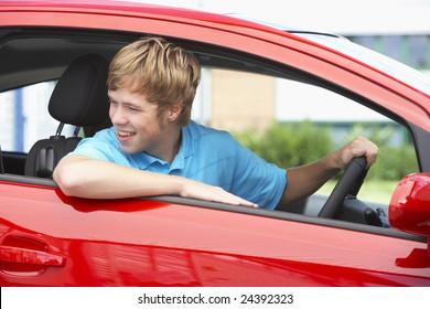 Teenage Boy Sitting In Car