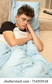 Teenage boy sleeping on a sofa