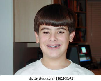 Teenage boy smiling with braces.  12 years old.