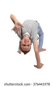 Teenage boy standing in a gymnastic bridge pose with a welcome gesture and smiling face isolated on white background