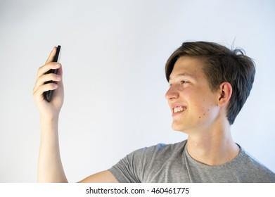 Teenage boy taking a selfie.
