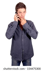 teenage boy talking on the phone isolated in white