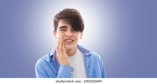 teenage boy with tooth or mouth pain