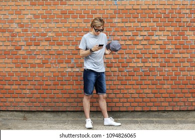 Teenage boy typing text message.Using smart phone.