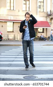 Teenage boy using smart phone