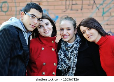 Teenage boys and girls portrait outdoors
