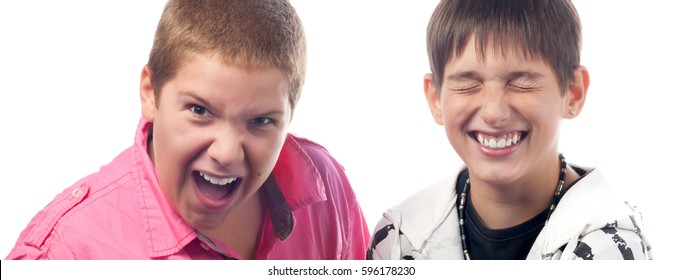 Teenage boys shouting, laughing and having fun isolated on white background.