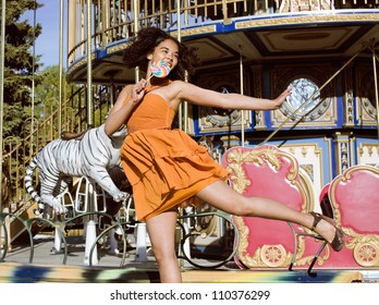 teenage with candy near carousels